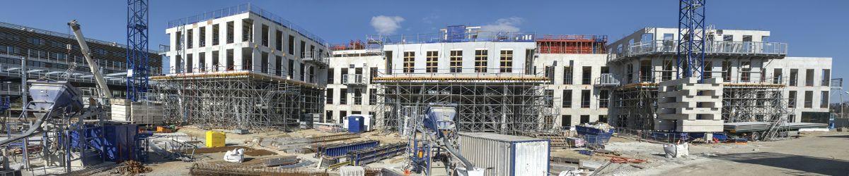 Baustelle von Bürogebäuden wo Aufträge über Ausschreibungen vergeben wurden